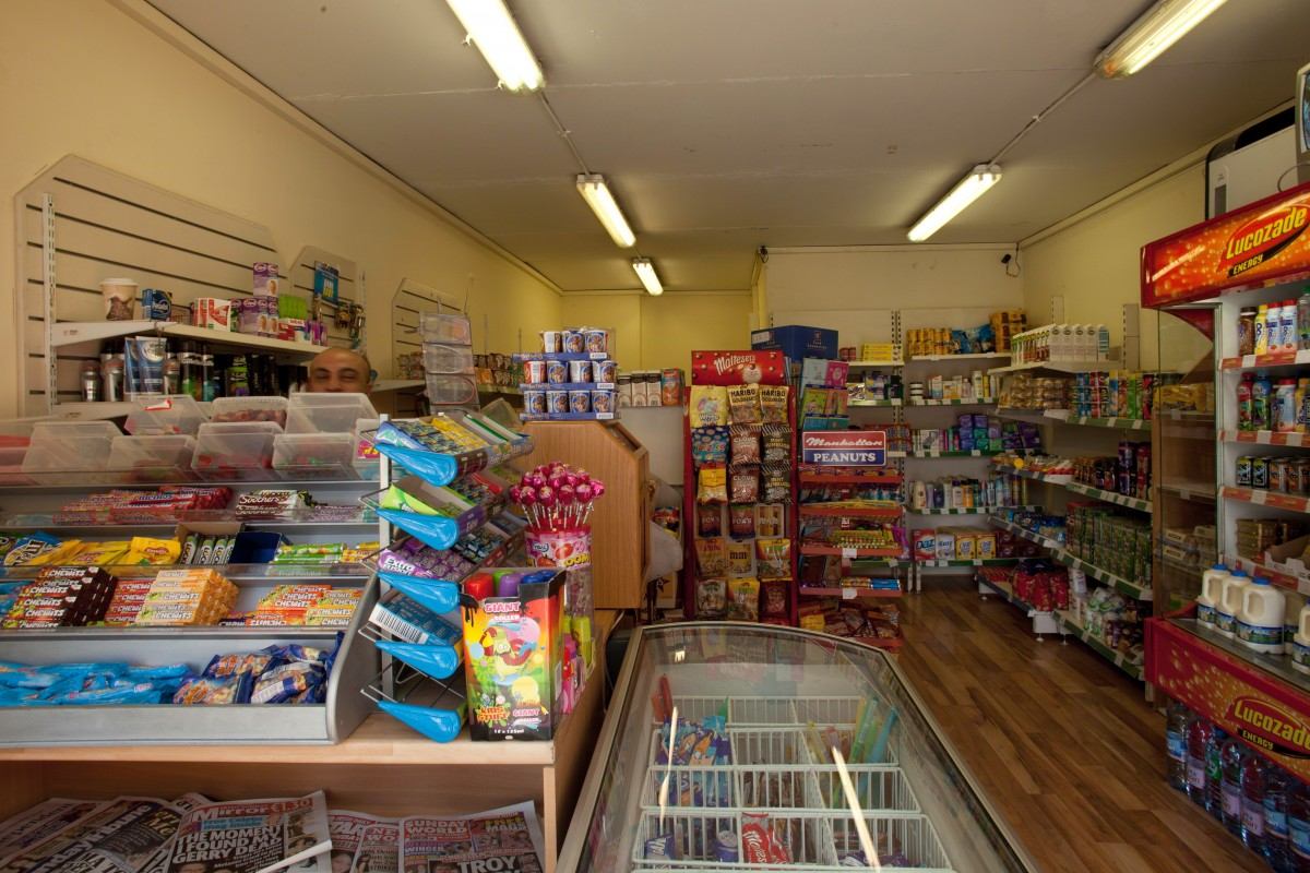 Family shop on Dorset street with owner heemed in by sweets www.paultierney.ie architectural photographer